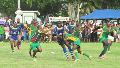 Rugby action on Saturday at the National Park during Guyana's 48-22 rout of Barbados. (Orlando Charles photo)