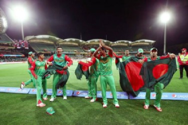 The victorious Bangladesh side celebrate their upset win over England and their advance to the World Cup quarter finals. (Photo courtesy ICC CWC website)