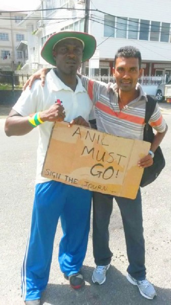 Courtney Crum-Ewing (left) and one of his Queen's College schoolmates during the protets against Attorney General Anil Nandlall. Courtney Crum-Ewing (left) and one of his Queen's College schoolmates during the protets against Attorney General Anil Nandlall.