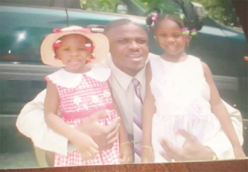 Posing with two of his three daughters, who live in the United States. The other lives in Antigua.