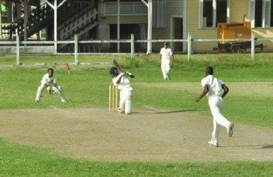 Ashmead Nedd drives a Timothy McCalmont's delivery firmly through the covers.