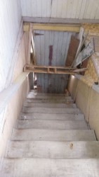 An inside stairway barred up.
