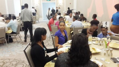 Marriott Hotel employees engaged in a training session in the main ballroom of the hotel.