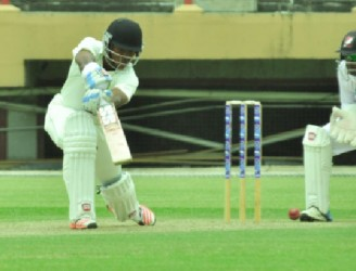 Skipper Leon Johnson plays elegantly through the offside although he fell short of a half century by one run. (Orlando Charles photo)
