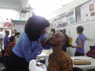 Optometrist Antonia McCurchin tests the eye pressure of a patient at Thursday's Glaucoma Screening event.