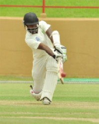 Rajendra Chandrika turns a delivery to leg during his innings of 51 yesterday. (Orlando Charles photo)