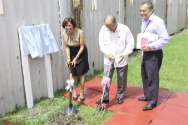 First Lady Deolatchmee Ramotar (left) and Minister Dr Bheri Ramsaran turn the sod for the extension of the maternity ward.