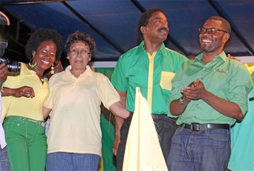 APNU's key Linden members Vanessa Kissoon and Sharma Solomon posing with Alliance for Change member Valerie Garrido-Lowe and APNU member Basil Williams moments after the unity rally in the mining town ended last night. (Arian Browne photo).