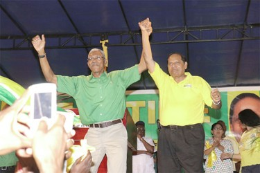'We ready for the vote': APNU+AFC Presidential and Prime Ministerial Candidates David Granger and Moses Nagamootoo do a jig at the coalition's unity rally in Linden last night. (Photo by Arian Browne)