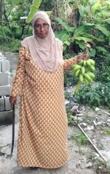 Farida Khan with a bunch of bananas she reaped in her yard