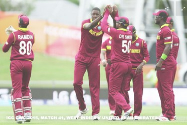 West Indies skipper Jason Holder (second from left) was voted the man of the match as the West Indies qualified for the quarter-finals of the 2015 World Cup after defeating the United Arab Emirates (UAE) yesterday. (Photo courtesy of CWC website)