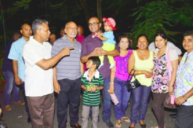 Head of State Donald Ramotar (second from left) and former President Bharrat Jagdeo (third from left) with some patrons of the State House fun day (GINA photo)