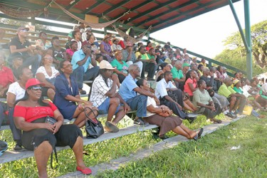 A section of those gathered for the vigil listen attentively to a speaker. About 250 persons turned up at the Parade Ground yesterday to pay tribute to slain political activist Courtney Crum-Ewing. (Photo by Arian Browne)