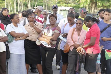 Some of the persons gathered for yesterday's vigil in honour of murdered political activist Courtney Crum-Ewing at the Parade Ground. (Photo by Arian Browne)