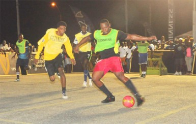 Action in the match-up between Plaisance-A (yellow) and Mahaicony United (green) in their group-D matchup of the Guinness Greatest of the Streets East Coast tourney