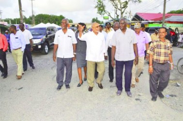 President Donald Ramotar (second from left) and officials walking along the roadway after the ceremony yesterday to start the Vreed-en-Hoop to Parika Road Project. (GINA photo)