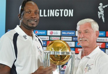 West Indies fast bowling legend Sir Curtly Ambrose and New Zealand fast bowling legend Sir Richard Hadlee hold the ICC Cricket World Cup trophy after a media conference at the Basin Reserve on March 19. WICB Media Photo/Philip Spooner