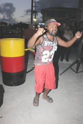 Dancing for the cup: A PPP supporter dancing at the PPP rally at Bourda Green last evening.