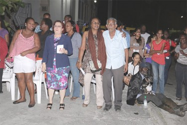 Presidential Advisor Gail Teixeira (second from left) among supporters at the PPP rally at Bourda Green last evening.