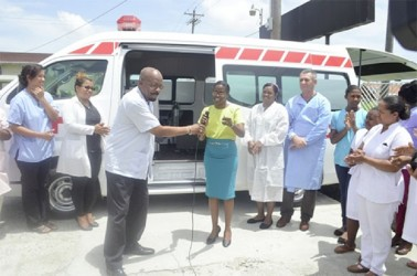 Minister of Local Government and Regional Development Norman Whittaker hands over the keys of the ambulance to Dr. Serena Bender of the Diamond Hospital. (Government Information Agency photo)