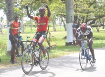 Team Coco's Hamza Eastman celebrating before crossing the finish line yesterday ahead of Orville Hinds.