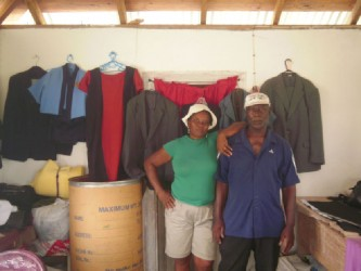 Aunty Jackie and Uncle Selman in their tailor shop at the front of their home.