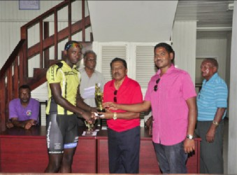 Akeem Arthur out pedaled a field of Guyana's premier cyclists to win the third and final leg of the Cheddi Jagan Memorial road race series yesterday in Essequibo, but Hamza Eastman's consistency enabled him to lift the overall trophy of this year's event. By virtue of winning the first leg, placing fifth in the second leg and finishing second yesterday, the Team Coco's standout was crowned this year's champion. In yesterday's 55-mile trek, which pedaled off from Supenaam, proceeded to Charity and ended at Anna Regina, Arthur (2hr:07m:09s)  led Eastman and last year's overall winner, Alanzo Greaves onto the podium. Veteran rider, Robin Persaud and United Bike Shop's Horrace Burrows were fourth and fifth respectively while Team Alanis' Paul Choo-Wee-Nam placed sixth. Yesterday's race commenced as cool as the weather in the Cinderella County and there was not much theatrics on the upward journey. When the wheelsmen turned back at Charity, the peloton was still mostly together save for a few stragglers and Orville Hinds who unfortunately suffered an early puncture.  There were several mini breaks on the way back to Anna Regina but the attackers were quickly wheeled in by the peloton.   The cyclists pretty much stuck to the script until Arthur solo attacked in the final 300m and held on for his first win of the season.  His attack went unchallenged as Eastman, the virtual leader heading into yesterday's leg was content on preserving his one point lead ahead of Greaves.  Eastman's tactic did not prove costly as he was able to edge out Greaves on the line in the bunch sprint.  Marica Dick (female), Julio Melville (Mountain Bike), Andrew Hicks (Junior) and Ralph Williams (veteran) were also categorical winners yesterday. Notes: The sum of 38 riders started in yesterday's race. The Memorial event is in it's 18th year. It is held to commemorate the life and works of former president, Cheddi Jagan. Jagan would have celebrated his 92nd birth anniversary yesterday. The initial l