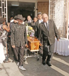 The coffin with the remains of businesswoman and cultural activist Margery Kirkpatrick being borne from the St Saviour's Parish Church, Saffon Street yesterday. Her widower Dougal Kirkpatrick is at right.  Margery Kirkpatrick died on Saturday. She was an ardent advocate for the chronicling and preservation of Chinese culture here.
