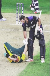 HELPING HAND! New Zealand's Grant Elliott lends a helping hand to South Africa's pace bowler Dale Steyn before hitting the penultimate delivery of Steyn's final over for six to send New Zealand through to their first World Cup final.