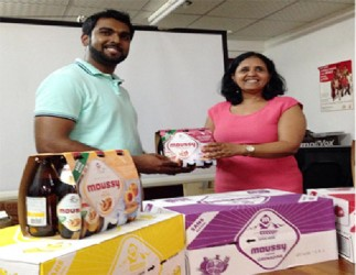 CEO of Southland International  Irzad Zamal handing over the Moussy beverage to Programme Manager of NAPS Dr. Shanti Singh