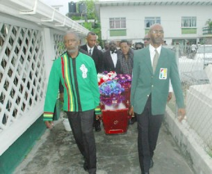 Charles Corbin, left and Garfield Wiltshire, right, lead the pallbearers delivering Shanomae Blackmore to her final resting place yesterday.