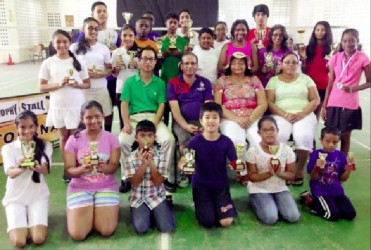 The prize winners display their trophies in the presence of the sponsors and parents.
