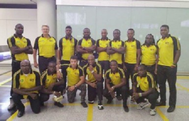 Guyana's rugby team pose for photos shortly after arriving in Hong Kong