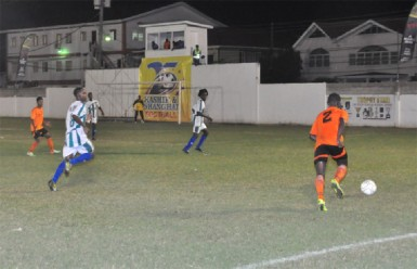 Slingerz FC right-back Les Charles-Critchlow (No.2) in the process of crossing the ball into the Victoria Kings penalty area during his side's hard-fought win