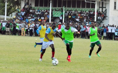 Morgan Learning Centre's Wayne Murray (left) and Chase Academy's Jeremy Garrett tussling for possession of a loose ball during their team's semi-final fixture at the Ministry of Education ground
