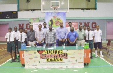 Members of the Youth Basketball Guyana (YBG) National Schools Championships launch committee alongside representatives of the Beharry Group of Companies, GABF, Banks DIH Limited and Digicel pose for a photo opportunity following the launch of the tourney yesterday.
