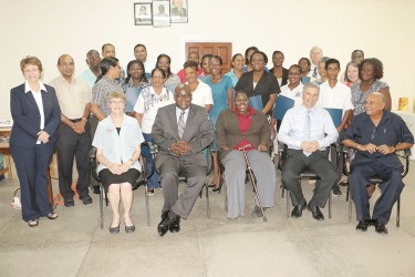 Participants and facilitators of the Intensive Coaching Program along with Chief Education Officer Olato Sam (seated second at left) and Coordinator of the Guyana Improving Teacher Education Project Tota Mangar (seated at right).