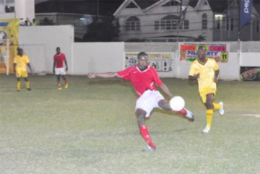 Riddim Squad's Amos Ramsay attempting to clear the ball out of his team's defensive third following an unsuccessful attack on their goal by Western Tigers