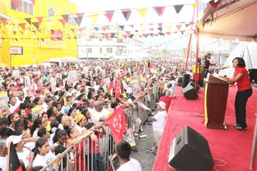 The crowd at the PPP rally at the Kitty Market Square yesterday being addressed by Africo Selman. (Arian Browne photo)