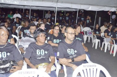 Minister of Natural Resources and the Environment Robert Persaud (right in front row) among the gathering at the WWF and other partners', Earth Hour 2015 observance at the National Park (GINA photo)