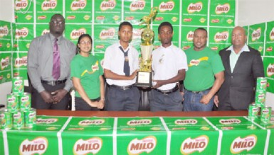The captains of Chase Academy and Dolphin Secondary with the trophy for the winning team in the presence of organizer Troy Mendonca and other officials.