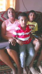 Omadat Singh's wife and two sons.