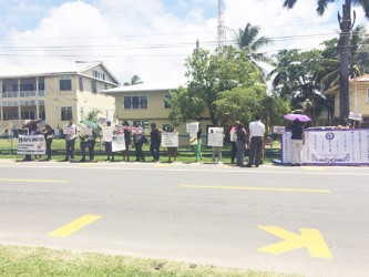 Protestors with placards
