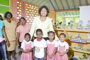 Minister of Education, Priya Manickchand with students of the newly commissioned school (GINA photo)