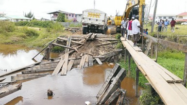 The truck that destroyed the Eastville Housing Scheme bridge was removed yesterday, while work was ongoing to build a pedestrian walkway for residents.