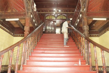 A worker painting the stairway leading to the Council Chamber from the Avenue of Republic entrance of City Hall