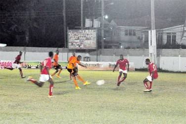 Anthony Abrams (centre)of Slingerz FC attempting a 24-yard right-footed attempt from outside the centre of the penalty box during his side's easy semi-final win over Riddim Squad