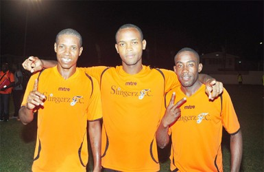 Slingerz FC goal scorers (from left to right)Anthony Abrams, Julian Wade and Devon Millington are all smiles after clinching their berth in the finale of the Kashif and Shanghai tourney following their semi-final win over Riddim Squad