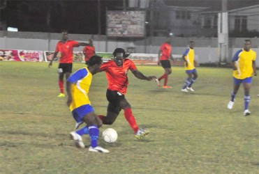 Pele forward Omallo Williamstrying to skip past Alpha United's left-back Abassi McPherson during semi-final action between the two clubs in the Kashif and Shanghai tourney