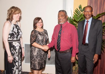 From left are Scotiabank Senior Vice-President Caribbean South, Anya Schnoor; outgoing Country Manager Amanda St. Aubyn, Prime Minister Samuel Hinds and new Guyana Country Manager Raymond Smith. (Scotiabank photo)